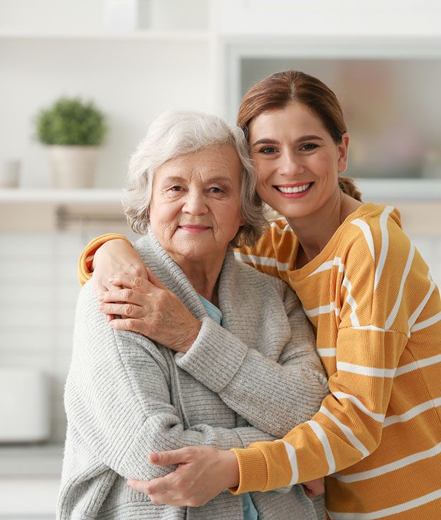 Cargiving daughter with elderly mother